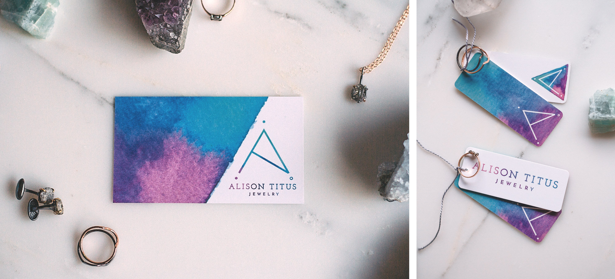 alison titus jewelry business card and jewelry tags surrounded by jewelry and gemstones